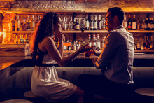 Young Lovely Couple Sitting At The Bar Stand And Talking