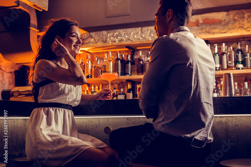 Happy girlfriend feeling relaxed spending time with her man Wallpaper Mural