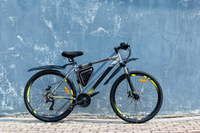 The Modern  Mountain Bicycle Near An Ancient Colored Wall