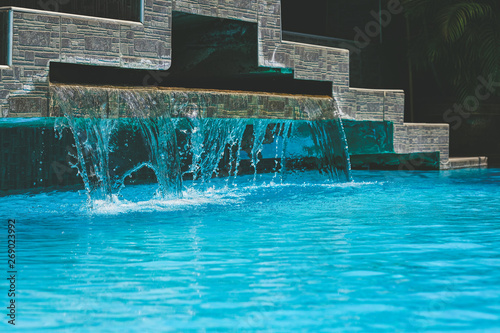 Foto auf AluDibond Stadion Water flows into the pool in the sport club.