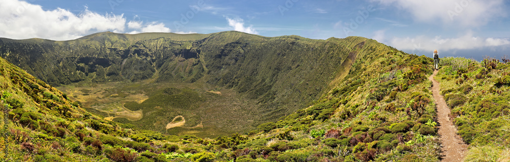 Fototapety, obrazy: Women is hiking along the crater rim of Caldeira of Faial, Azores