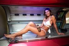 Pretty Girl In White Bikini Posing In Tanning Booth