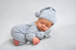 Leinwandbild Motiv Sleeping newborn boy in the first days of life on white background
