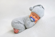 Sleeping Newborn Boy With Baby's Dummy In The First Days Of Life On White Background