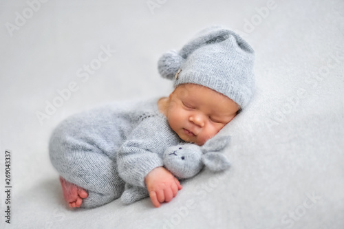 Fototapeta Sleeping newborn boy in the first days of life on white background obraz