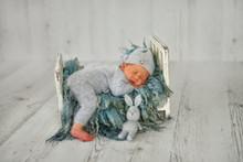 A Newborn Baby Boy Is Sleeping...