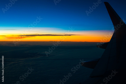 Airplane wing colourful sunset sky