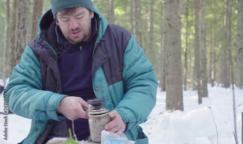 Valokuva  Scientist ecologist closing jars with soil samples