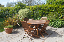 Terrace And Wooden Garden Furniture In A Garden During Spring