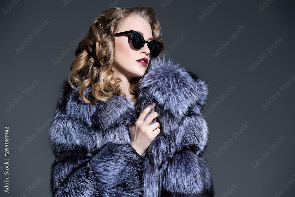 Fototapeta lovely lady in a fur coat