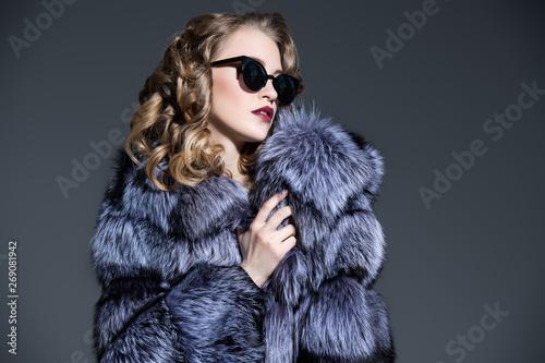 lovely lady in a fur coat Fototapete