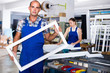 Leinwandbild Motiv Portrait of experienced male worker with plastic window frame