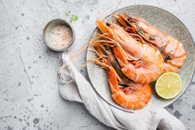Giant Fresh Tiger Prawns On Plate Over Dark Stone Background, Top View