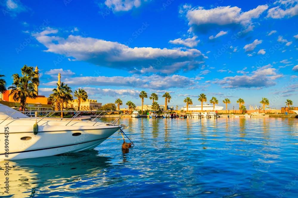 Fototapeta White luxury yachts in a sea harbor of Hurghada, Egypt. Marina with tourist boats on Red Sea