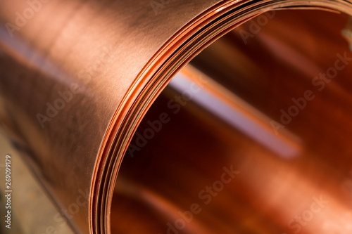 Fototapeta copper sheet is twisted into a large roll obraz