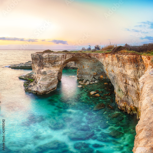 Dramatic seascape with cliffs, rocky arch at Torre Sant Andrea Wall mural
