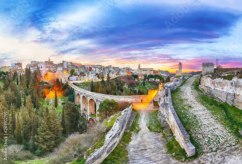 Fotobehang Oude gebouw Gravina in Puglia ancient town, bridge and canyon at sunrise
