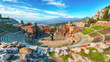 canvas print picture - Ruins of ancient Greek theater in Taormina and Etna volcano in the background.