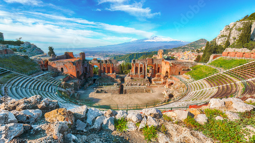 Ruins of ancient Greek theater in Taormina and Etna volcano in the background Canvas Print
