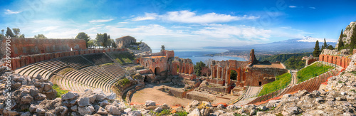 Ruins of ancient Greek theater in Taormina and Etna volcano in the background Fototapeta
