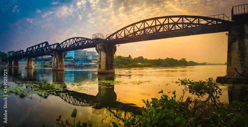 The bridge on the river Kwai at sunrise. Railway in Kanchanaburi, Thailand. Panorama