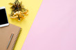 canvas print picture Office desk working space - Flat lay top view of a working space with white blank notebook page, plant tree and mock up phone on pastel background. Pastel pink yellow color background space concept.