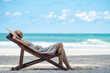 Selective focus of young asian adult traveler in casual wear sleeping on sunbed on sand beach in tropical island in summer day holidays vacation with blurred blue sea, beach and sky backgrounds.