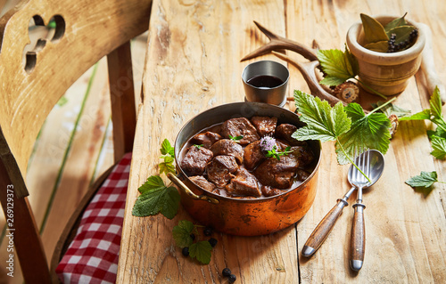 Vintage copper pot with spicy venison goulash