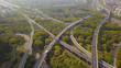Aerial view of cars on highway junctions. Bridge roads or streets in structure of architecture and transportation concept. Top view. Urban city, Shanghai at noon, China.