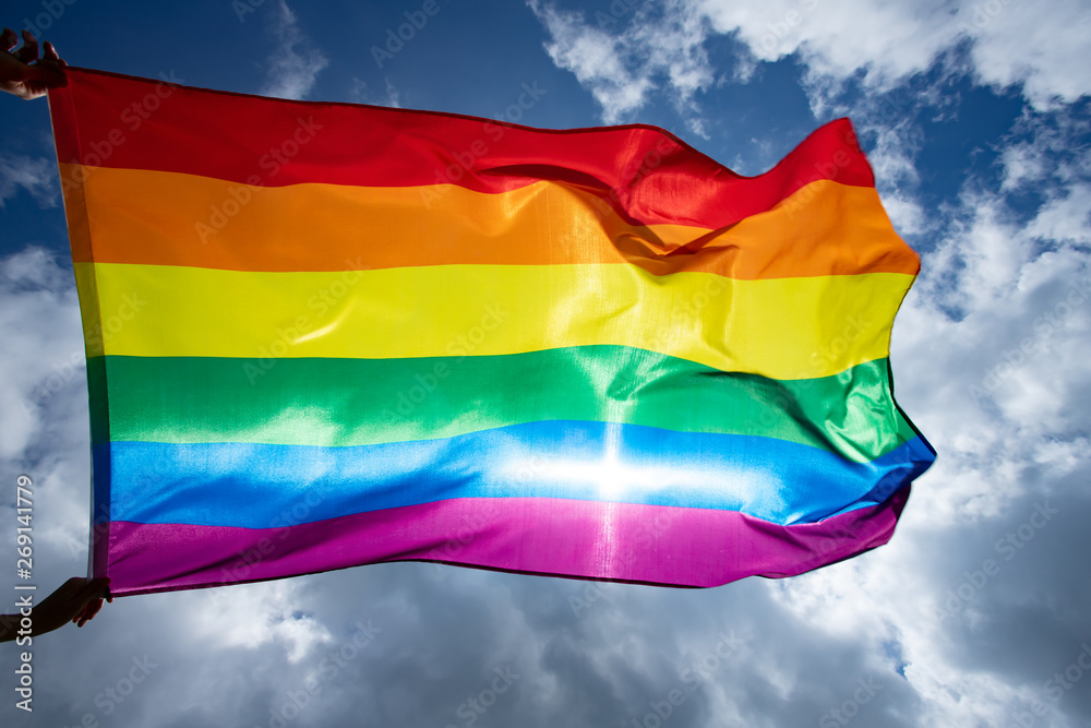Fototapety, obrazy: Colorful LGBT flag blows in the breez.