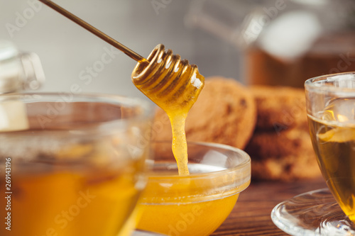 Cup of tea with lemon and honey on wooden background. Canvas Print