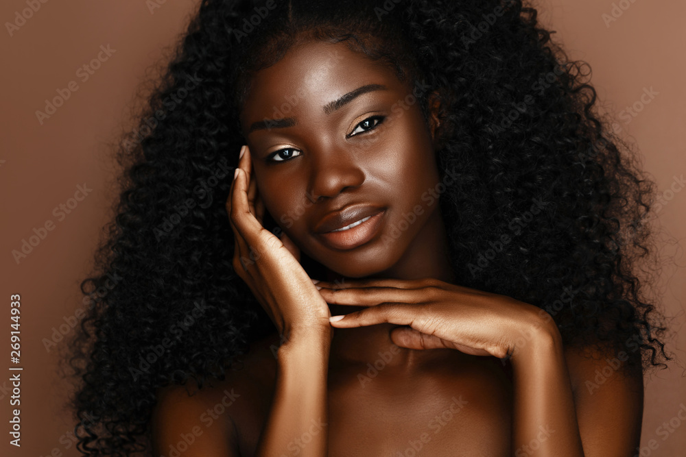 Fototapeta Beautiful skin care models with perfect dark skin and curly hair. African Beauty, spa treatment concept.