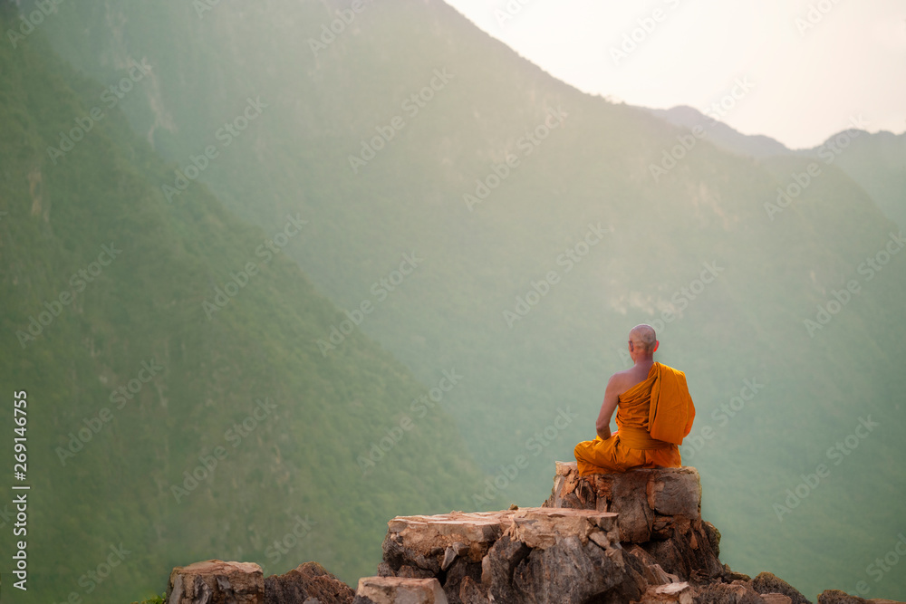 Fototapeta Buddha monk practice meditation on mountain