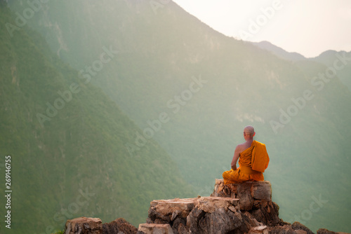 Buddha monk practice meditation on mountain Fototapet
