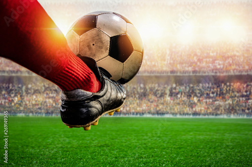 Obraz red soccer player kicking ball action in the stadium - fototapety do salonu