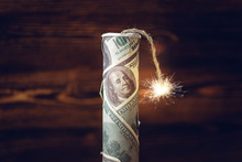 Bomb Of Money, Hundred-dollar Bills With A Burning Fuse. Waiting For The Explosion. Concept Of The Financial Crisis