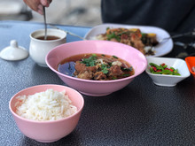 """Break Fast With Pork Clear Soup In Pink Bowl And Rice In Pink Cup, Delicious Of  Thai Food , Name Of This Menu In Thailand : """"Kao Lao  Moo Toon  """"."""