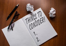Conceptual Hand Writing Showing Things To Consider. Concept Meaning Think About Something Carefully In Order To Make Decision Notebook Small Wrinkled Paper Balls Reading Glasses Wooden Table