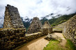 canvas print picture - Sunshine breathtaking view of Machupicchu stone anchient walls and temple among mountains covered with clouds