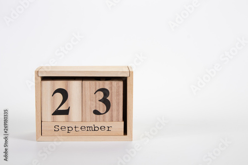 Fotografia  Wooden calendar September 23 on a white background