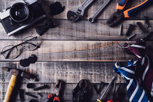 Foto op Aluminium Happy fathers day concept. Top view of border of tools and ties, retro film camera on dark wooden table background. Flat lay.