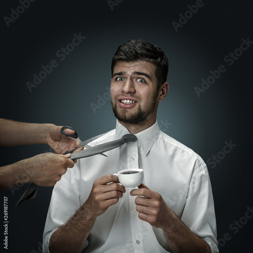 A male model with a cup of coffee on dark background Wallpaper Mural