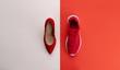 Leinwandbild Motiv A studio shot of running vs high heel shoe on color background. Flat lay.