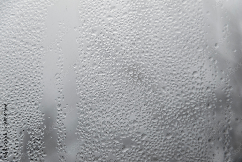 Fototapeta condensation drops on window glass. autumn rainy day background