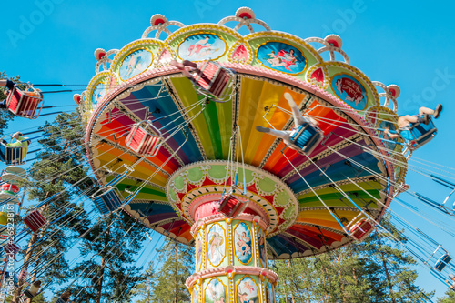 Leinwand Poster Kouvola, Finland - 18 May 2019: Ride Swing Carousel in motion in amusement park