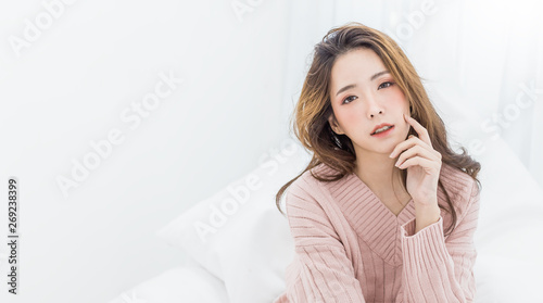 Obraz Portrait of young beautiful sexy asian woman relax in her bedroom. Smile happy face asian girl isolated on white background. Beauty treatment perfect clear skin japanese makeup  lifestyle concept - fototapety do salonu