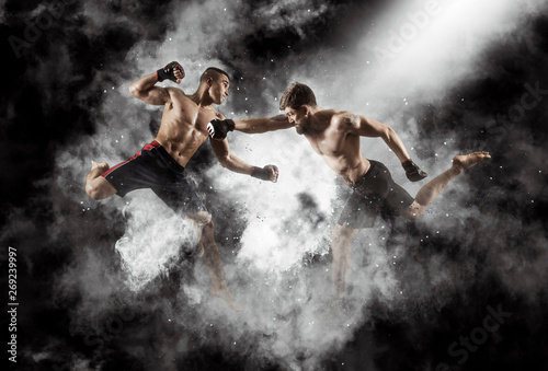 Leinwand Poster MMA boxers fighters fight in fights without rules