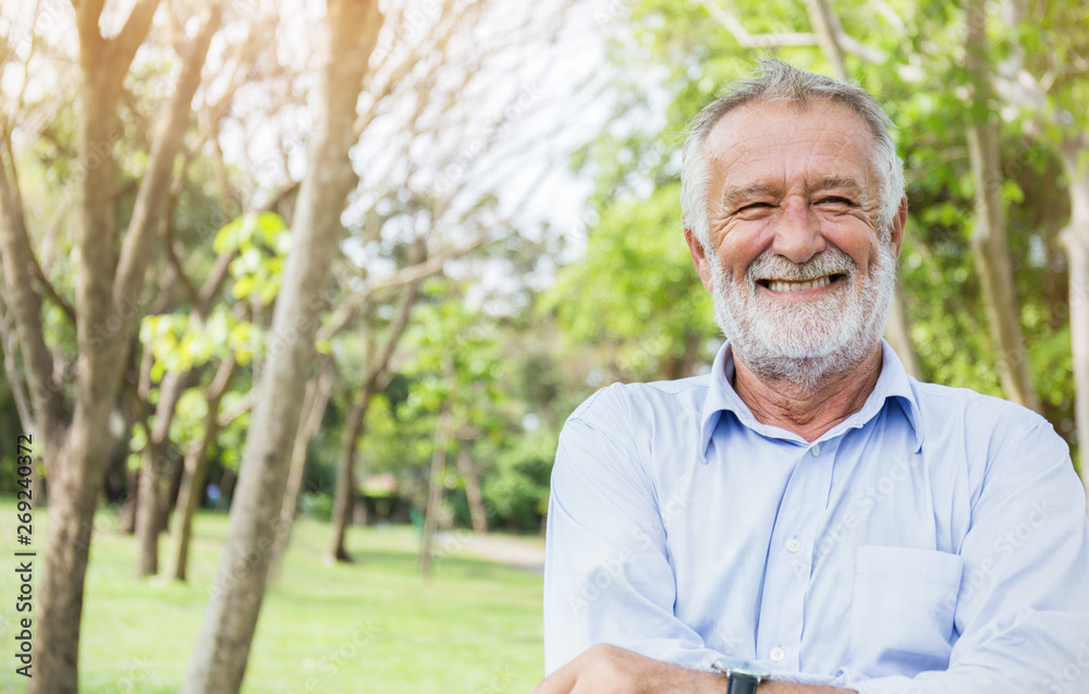Fototapety, obrazy: Portrait of healthy happy smile senior elderly caucasian old man in the park outdoors with copy space. Spring autumn golden age healthcare cheerful lifestyle freedom retirement concept