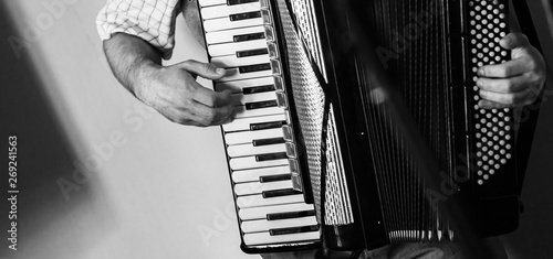 Fotografia, Obraz Accordionist plays vintage accordion