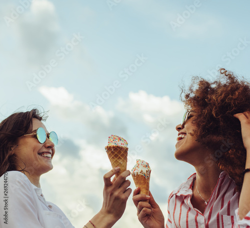Friends with icecream enjoying together Wall mural